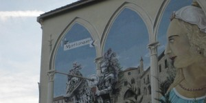 Mural on town wall, Monflanquin